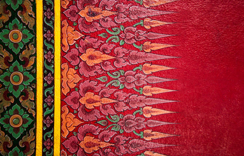 Λεπτομέρεια ταϊλανδικού παραδοσιακού που χρωματίζεται στον τοίχο ναών. στοκ εικόνες