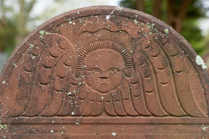 Λεπτομέρειες στην καφετιά ταφόπετρα στοκ εικόνα