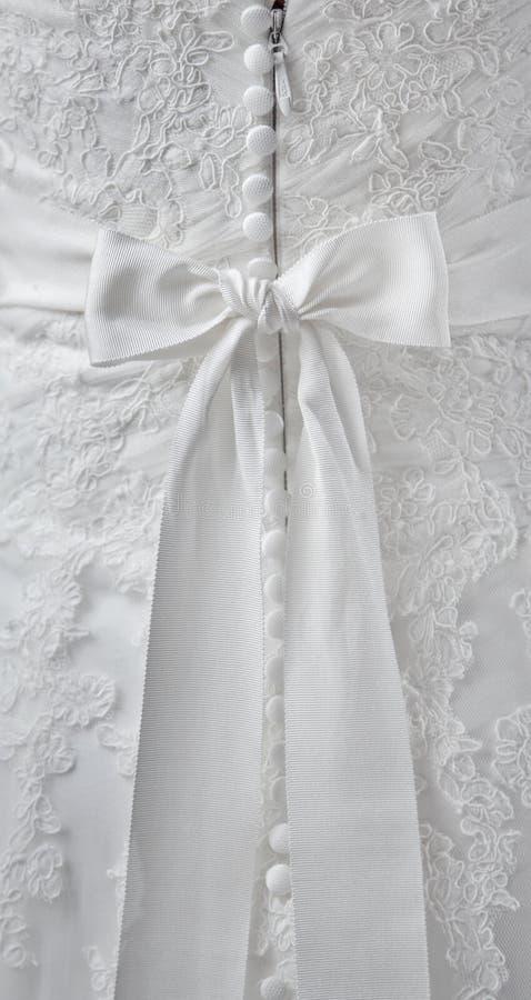 Λεπτομέρειες του γαμήλιου φορέματος στοκ εικόνες