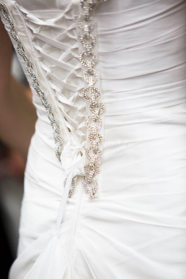 Λεπτομέρειες του γαμήλιου φορέματος στοκ εικόνα με δικαίωμα ελεύθερης χρήσης