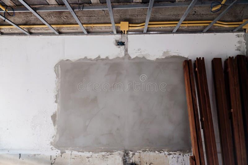 Λεπτομέρειες του Τείχους στη διαδικασία κατασκευής Έννοια της ανακαίνισης σπιτιού στοκ εικόνες