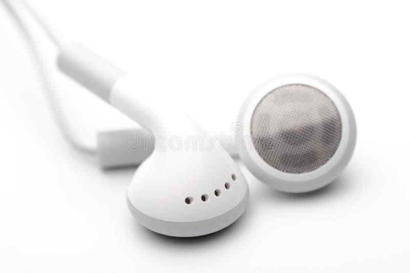 λευκό ακουστικών στοκ εικόνα με δικαίωμα ελεύθερης χρήσης