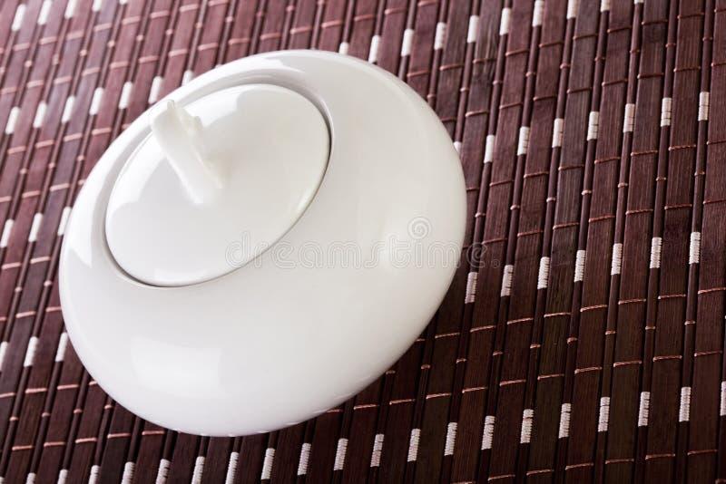 λευκό ζάχαρης κύπελλων placemat στοκ εικόνες με δικαίωμα ελεύθερης χρήσης