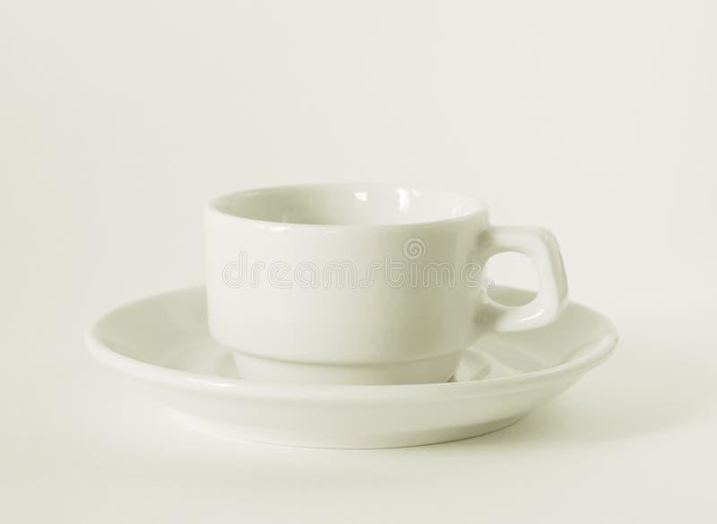 λευκό πιατακιών φλυτζανιών καφέ στοκ εικόνες