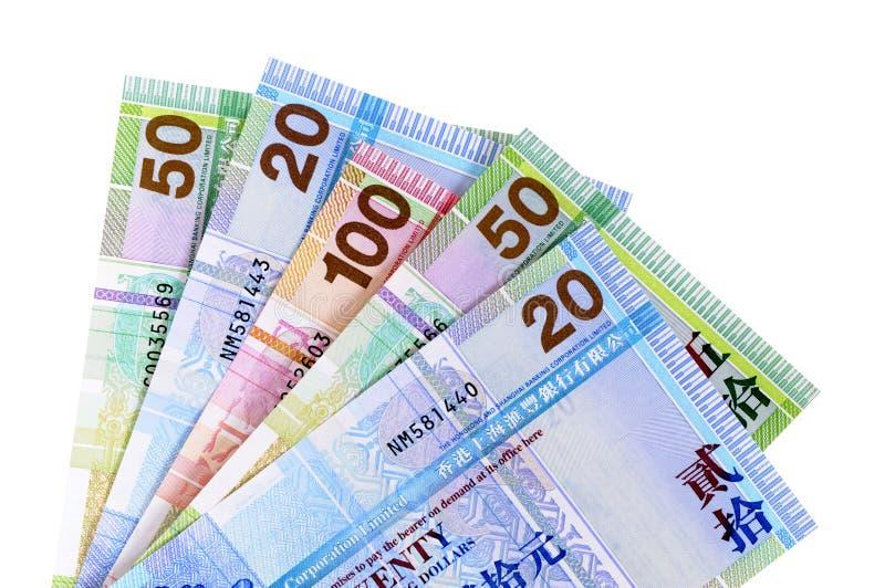 Λογαριασμοί νομίσματος δολαρίων Χονγκ Κονγκ που απομονώνονται στο λευκό στοκ εικόνες