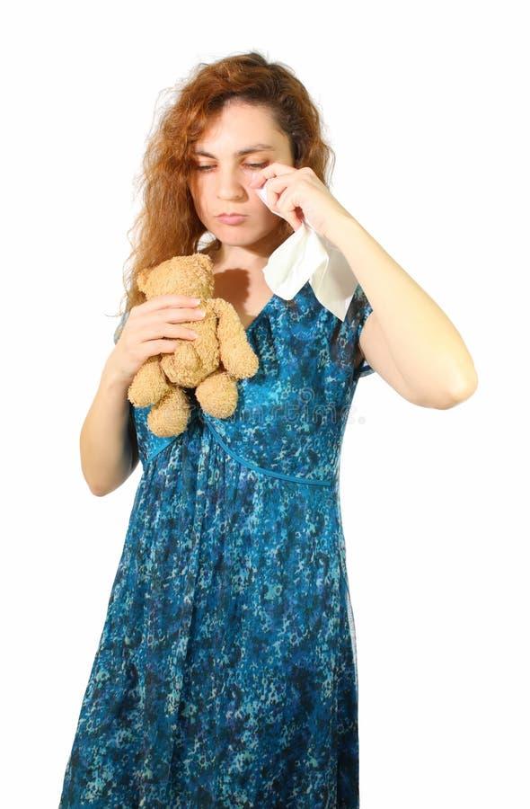 Λυπημένη γυναίκα με την teddy-άρκτο στοκ εικόνα με δικαίωμα ελεύθερης χρήσης