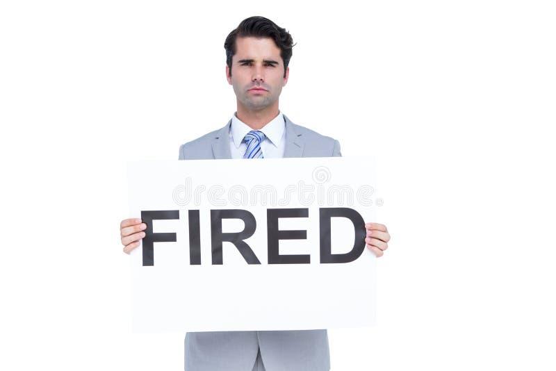 Λυπημένος επιχειρηματίας που κρατά ένα βαλμένο φωτιά σημάδι στοκ φωτογραφίες με δικαίωμα ελεύθερης χρήσης