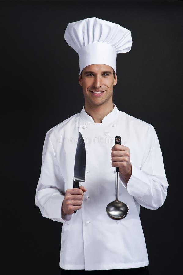 Μάγειρας αρχιμαγείρων στο σκοτεινό κλίμα στοκ εικόνα
