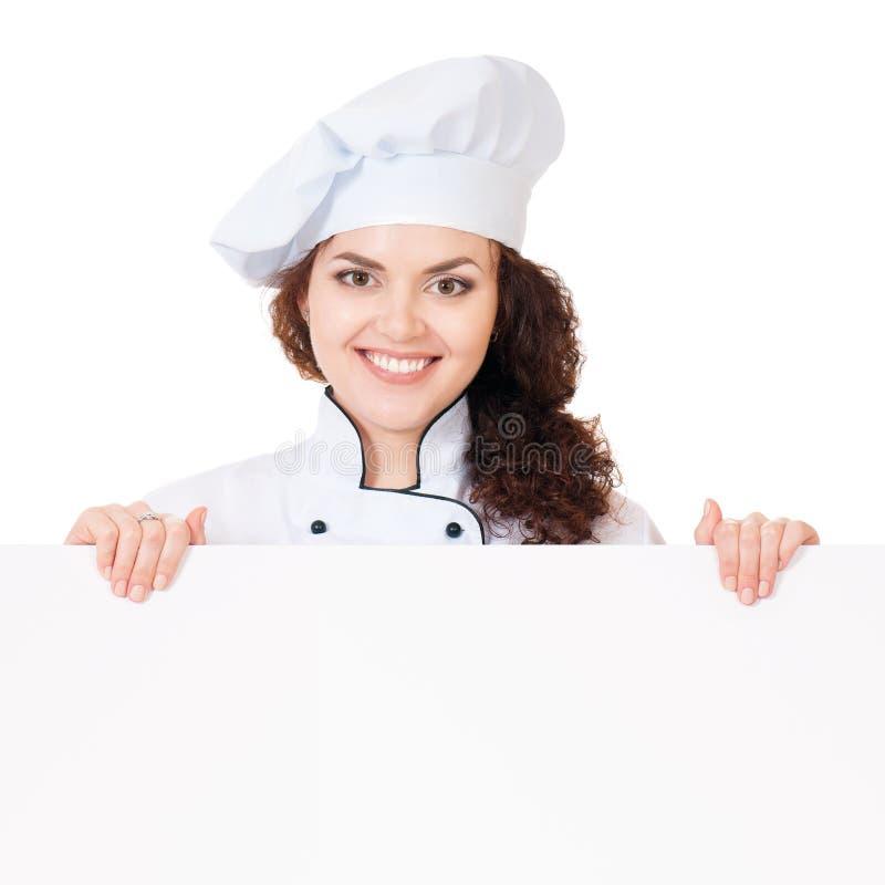 Μάγειρας γυναικών με το λευκό κενό πίνακα στοκ φωτογραφίες