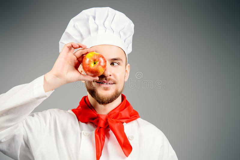 Μάγειρας με το μήλο στοκ φωτογραφία με δικαίωμα ελεύθερης χρήσης
