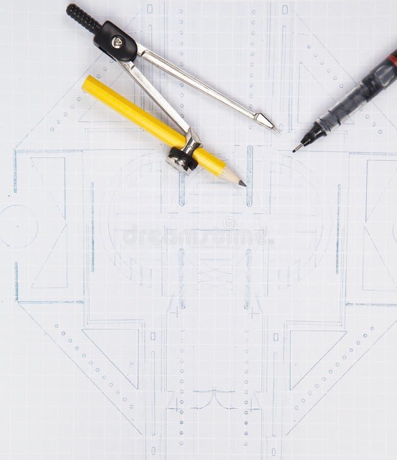 Μάνδρα πυξίδων και γραψίματος στο σχέδιο αρχιτεκτόνων στοκ εικόνες με δικαίωμα ελεύθερης χρήσης