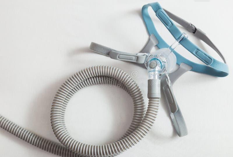Μάσκα καλυμμάτων CPAP, που συνδέει με το λουρί και τη μάνικα που βάζουν σε ένα β στοκ φωτογραφίες