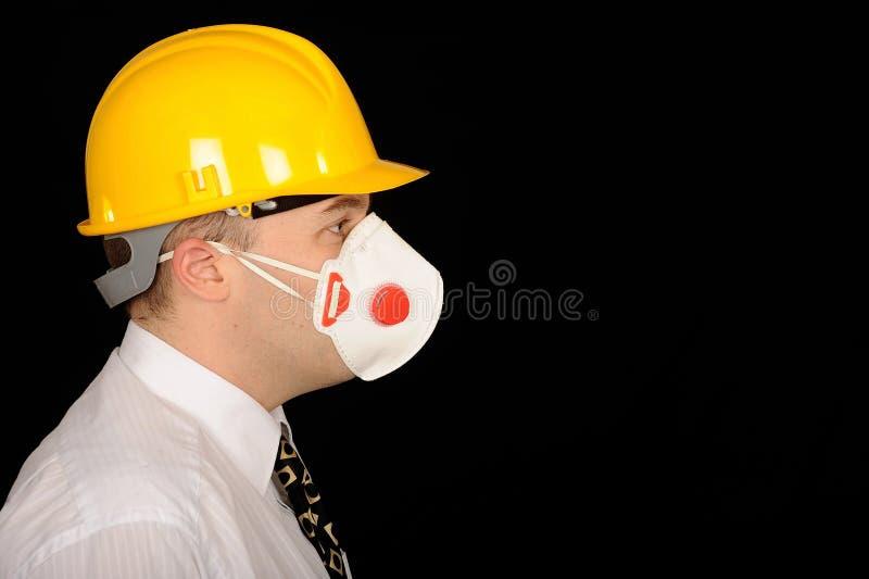 μάσκα που φορά τον εργάτη στοκ εικόνα