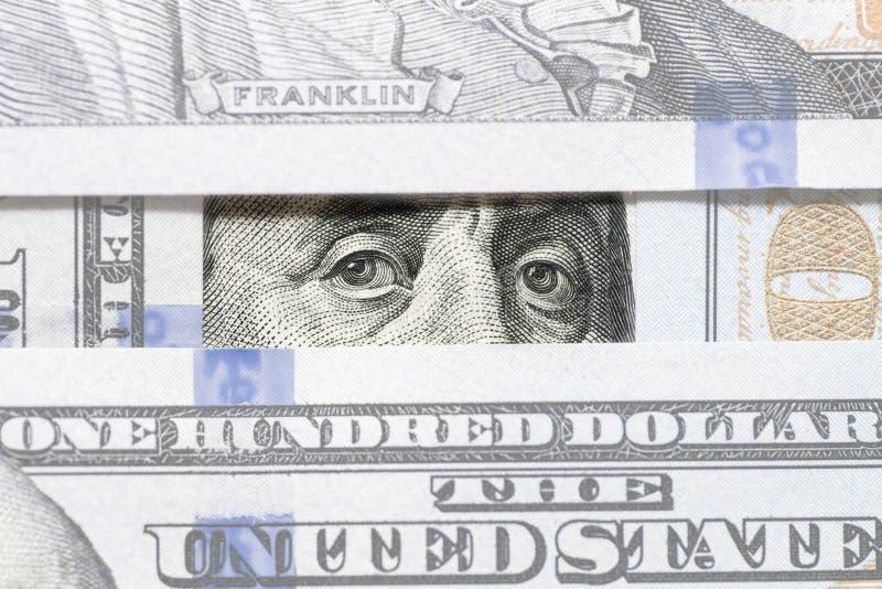 Μάτια του Benjamin Franklin μεταξύ της κινηματογράφησης σε πρώτο πλάνο τραπεζογραμματίων εκατό δολαρίων Μάτια της προσοχής του Be στοκ εικόνα με δικαίωμα ελεύθερης χρήσης