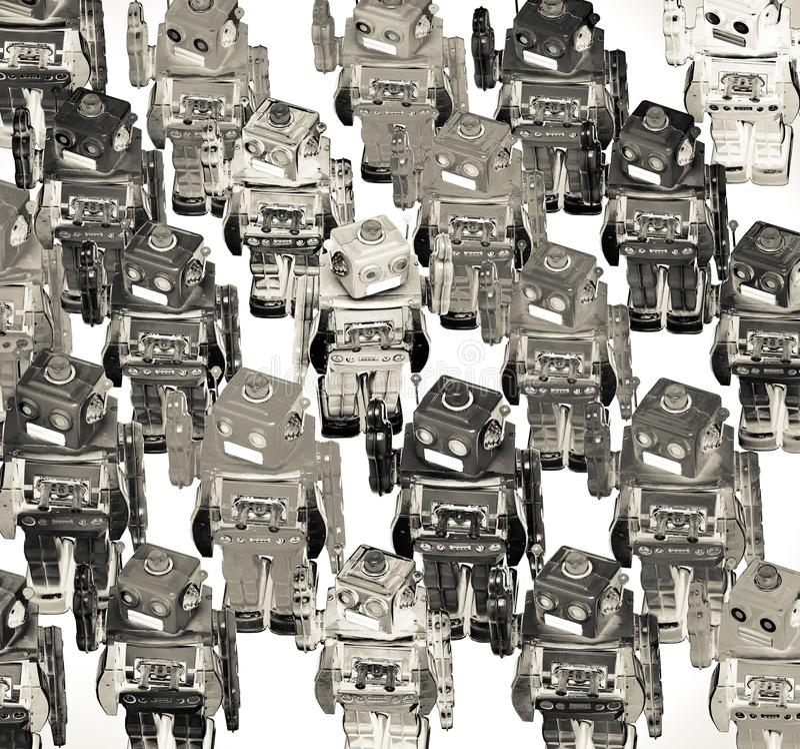 Μέρη των ρομπότ χρώματος σε ένα πλήθος με στη μετάβαση στοκ εικόνα