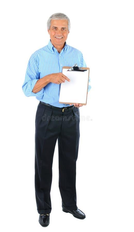 Μέσος ηλικίας επιχειρηματίας με το χαρτόνι συνδετήρων στοκ φωτογραφία