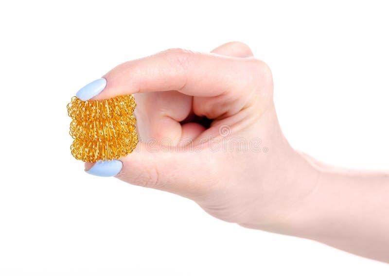Μέταλλο massager για τα δάχτυλα υπό εξέταση στοκ φωτογραφίες