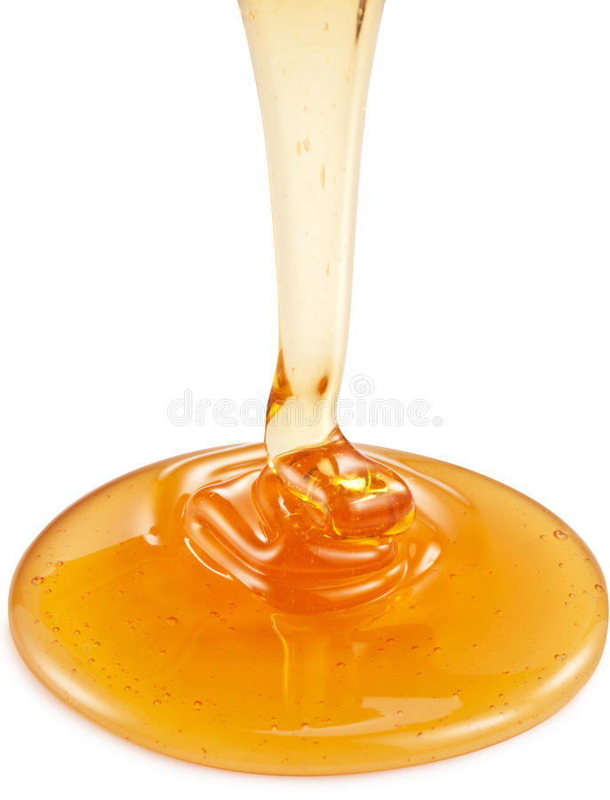Μέλι που ρέει από το ξύλινο ραβδί στοκ φωτογραφία με δικαίωμα ελεύθερης χρήσης