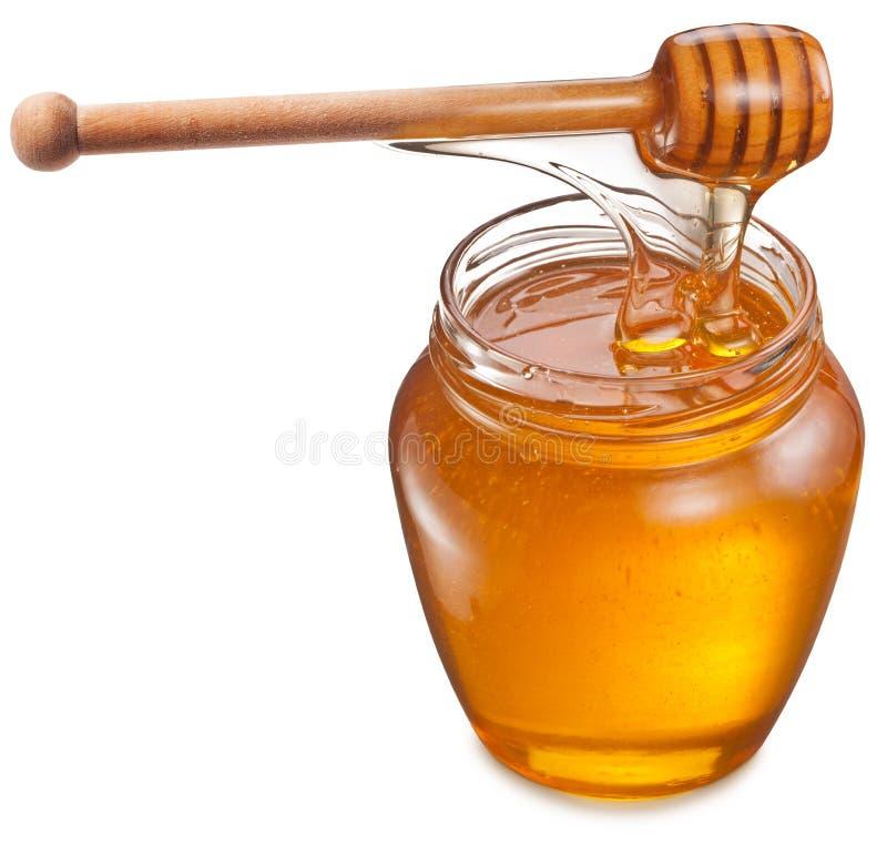 Μέλι που ρέει στο βάζο γυαλιού στοκ φωτογραφία με δικαίωμα ελεύθερης χρήσης