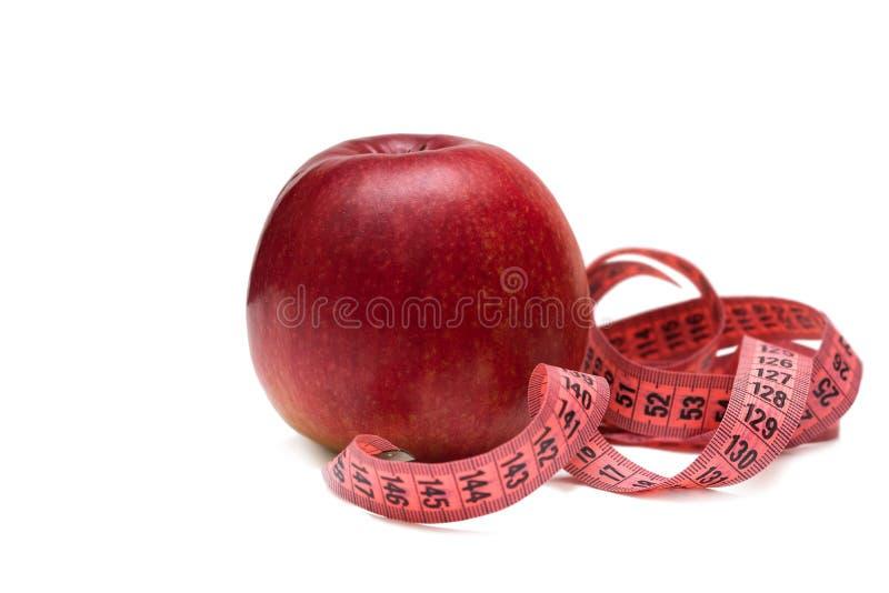 Μήλα με την ταινία μέτρου στο άσπρο υπόβαθρο, υγιής τρόπος ζωής στοκ φωτογραφίες με δικαίωμα ελεύθερης χρήσης