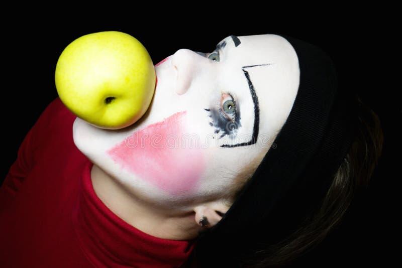 μήλο που δαγκώνει mime στοκ εικόνα με δικαίωμα ελεύθερης χρήσης