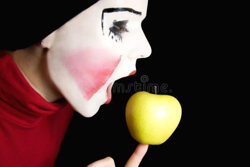 μήλο που δαγκώνει mime στοκ φωτογραφίες