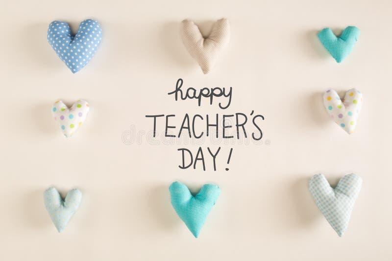 Μήνυμα ημέρας Teaher ` s με τα μπλε μαξιλάρια καρδιών στοκ φωτογραφίες με δικαίωμα ελεύθερης χρήσης