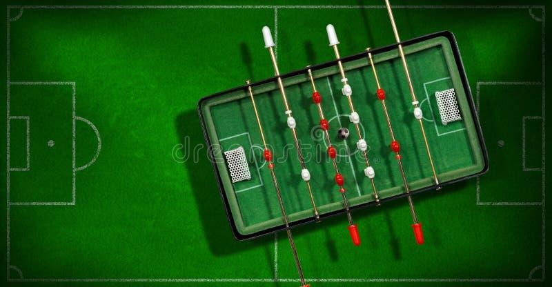 Μίνι επιτραπέζιο ποδοσφαιρικό παιχνίδι με τη σφαίρα ποδοσφαίρου στοκ φωτογραφία