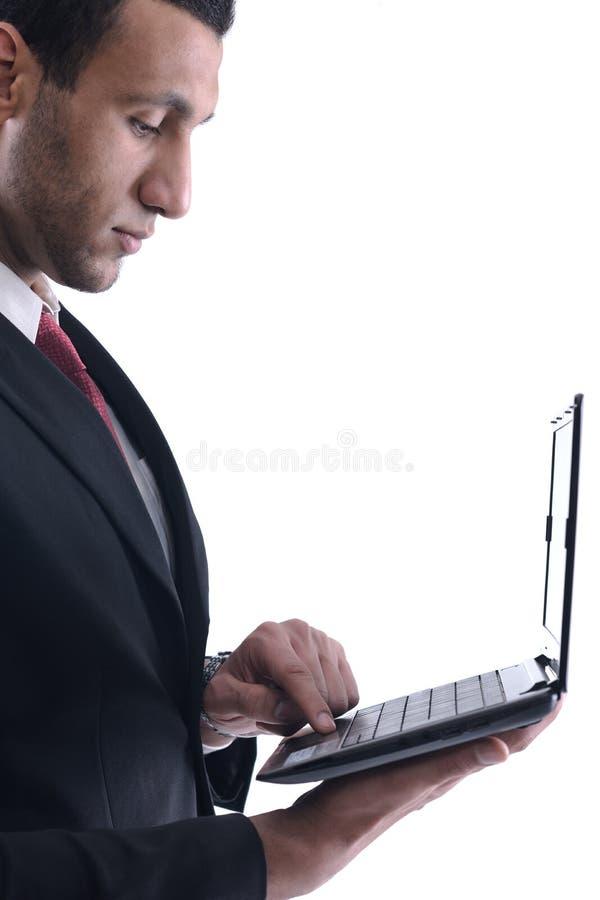 μίνι εργασία χαμόγελου ατόμων lap-top επιχειρησιακής λαβής στοκ φωτογραφίες