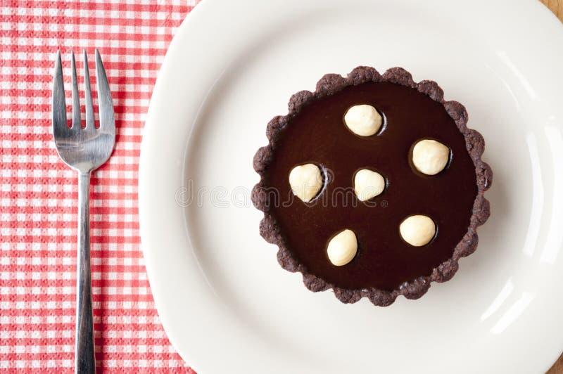 Μίνι σοκολάτα ξινή με το καρύδι στοκ εικόνες