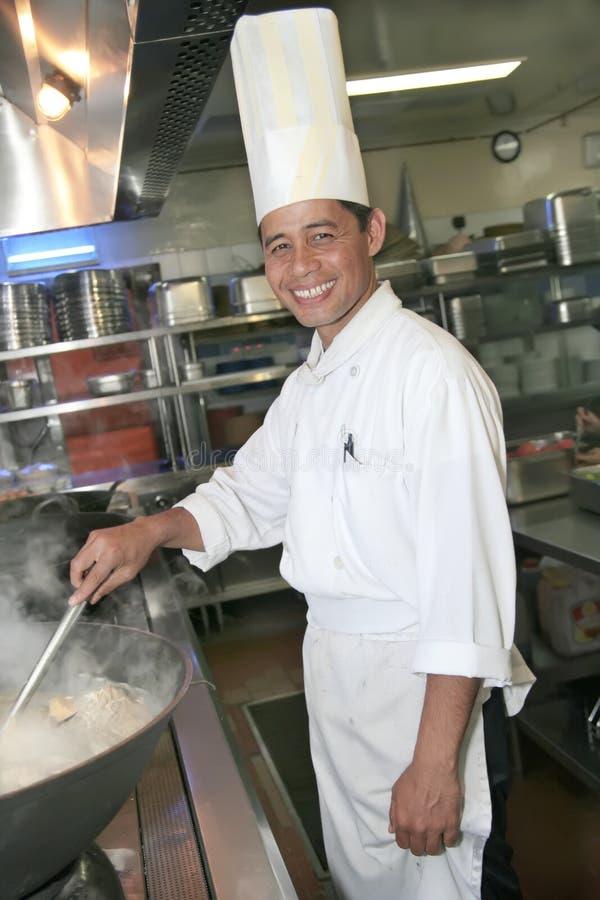 μαγειρεύοντας κουζίνα αρχιμαγείρων στοκ εικόνες