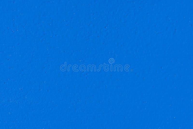 Μακρο εικόνα μιας βασιλικής μπλε χρωματισμένης ξύλινης επιτροπής στοκ φωτογραφία