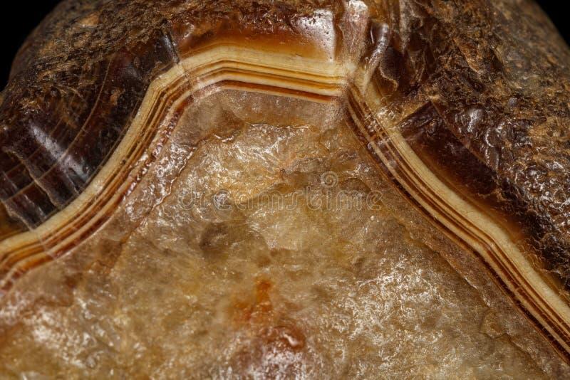 Μακρο ορυκτός αχάτης πετρών στο μαύρο υπόβαθρο στοκ φωτογραφίες με δικαίωμα ελεύθερης χρήσης