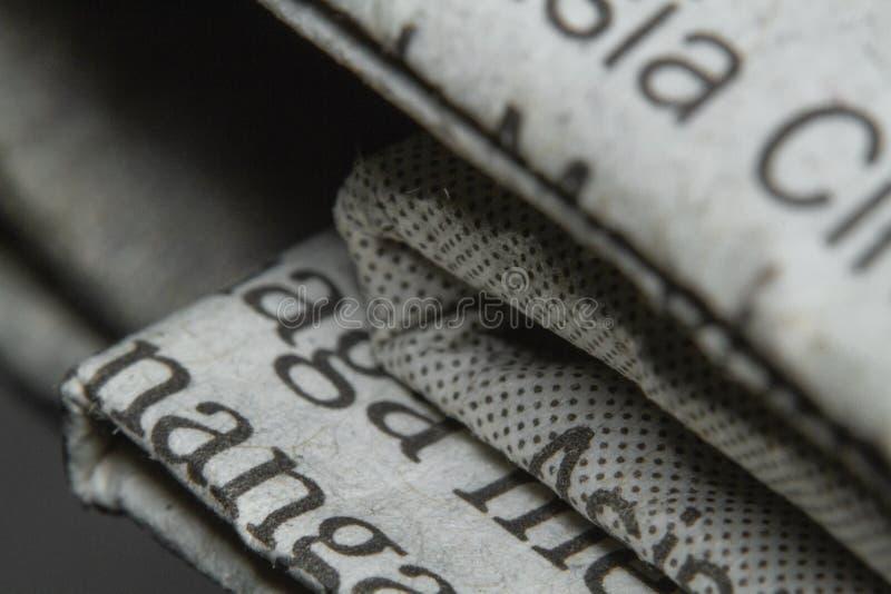 Μακρο πυροβολισμοί μια εικόνα κινηματογραφήσεων σε πρώτο πλάνο εφημερίδων στοκ φωτογραφίες