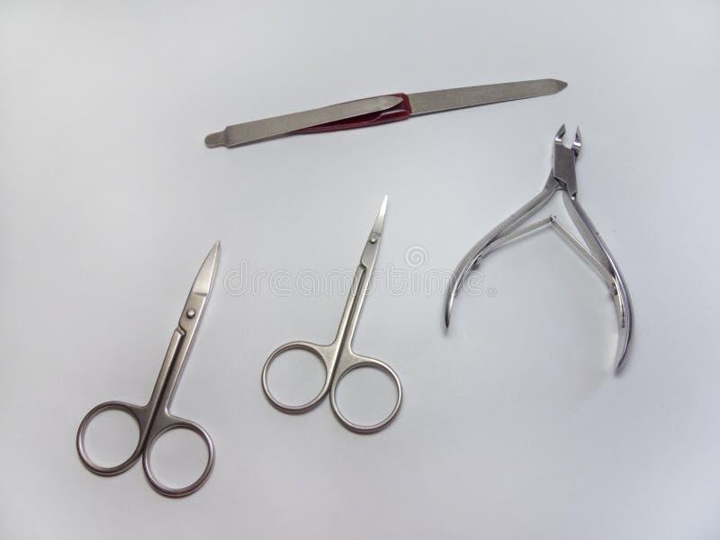 Μανικιούρ καθορισμένο: Nipper καρφιών, ευθύ ψαλίδι  ψαλίδι επιδερμίδων (ψαλίδι καρφιών που κάμπτεται) και nailfile στοκ φωτογραφίες με δικαίωμα ελεύθερης χρήσης