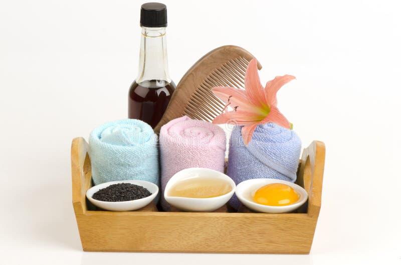 Μαριναρισμένος με το μέλι πετρελαίου σουσαμιού και το λέκιθο αυγών για την τρίχα και τις διασπασμένες άκρες στοκ φωτογραφία με δικαίωμα ελεύθερης χρήσης