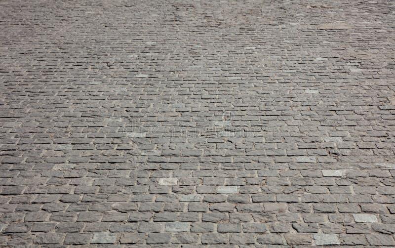 Μαρμάρινη στρωμένη πέτρα οδός, υπόβαθρο σύστασης, άποψη άνωθεν στοκ φωτογραφίες