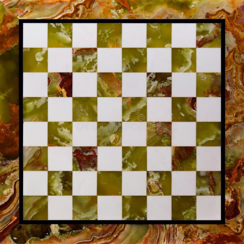 Μαρμάρινος πίνακας σκακιού πετρών - τοπ άποψη ενός κομψού και παλαιού πίνακα σκακιού κενού στοκ εικόνες
