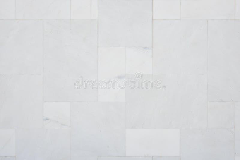 Μαρμάρινο διαμορφωμένο σύσταση υπόβαθρο τοίχων κεραμιδιών άνευ ραφής στοκ εικόνα