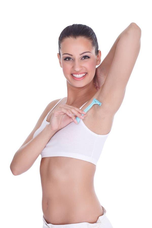Μασχάλες ξυρίσματος γυναικών στοκ φωτογραφία με δικαίωμα ελεύθερης χρήσης