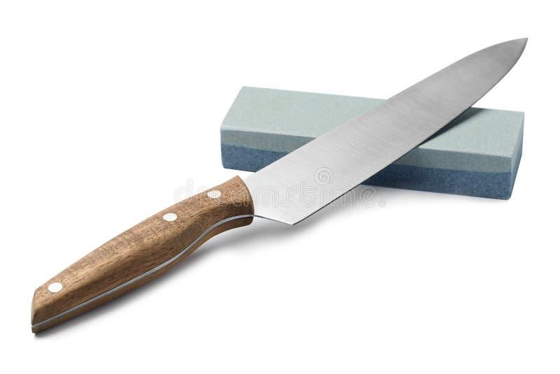 Μαχαίρι και ακονόλιθος του αιχμηρού προϊσταμένου που απομονώνονται στοκ εικόνα