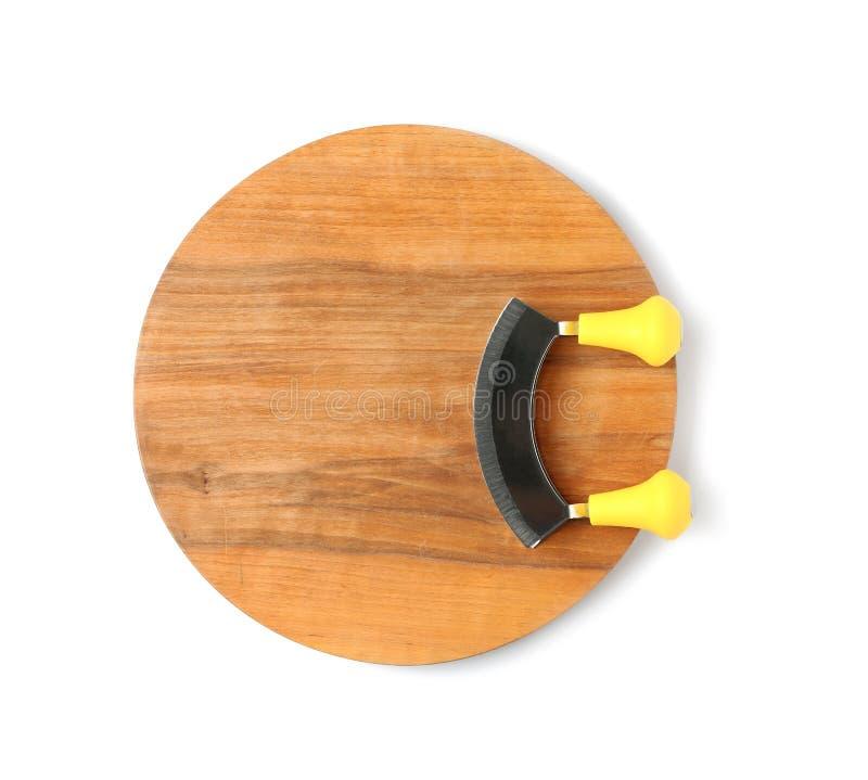 Μαχαίρι Mezzaluna με τον ξύλινο πίνακα, τοπ άποψη στοκ φωτογραφίες με δικαίωμα ελεύθερης χρήσης