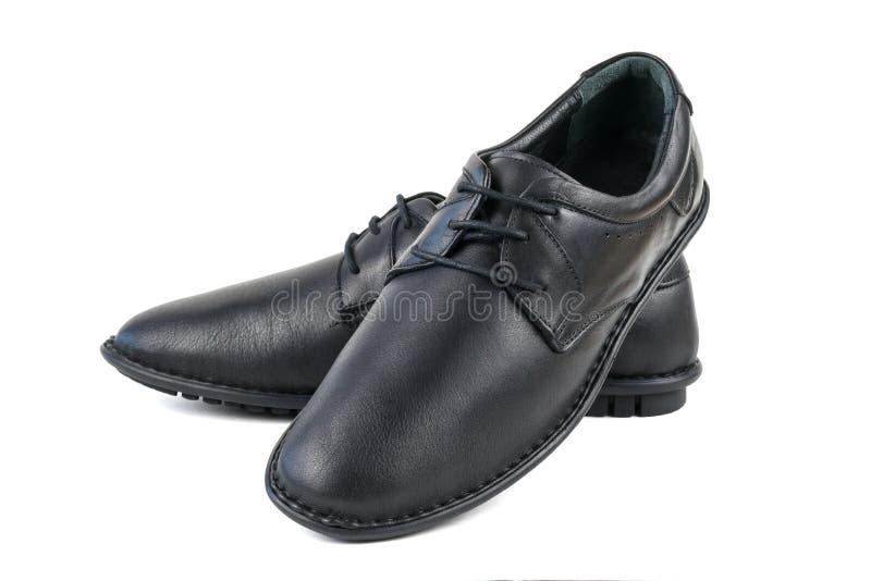 Μαύρα γνήσια παπούτσια δέρματος που απομονώνονται στο άσπρο υπόβαθρο στοκ φωτογραφίες με δικαίωμα ελεύθερης χρήσης