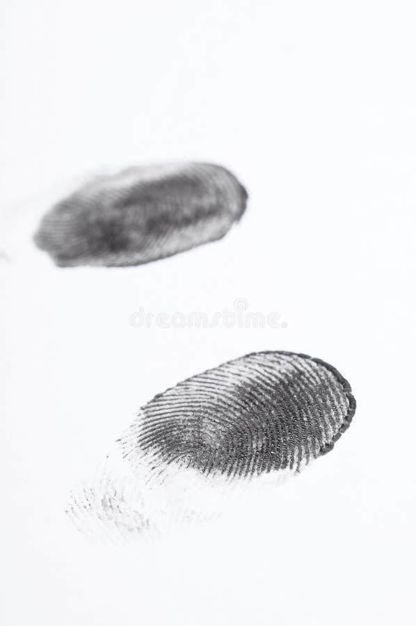 Μαύρα δακτυλικά αποτυπώματα σε χαρτί στοκ εικόνες
