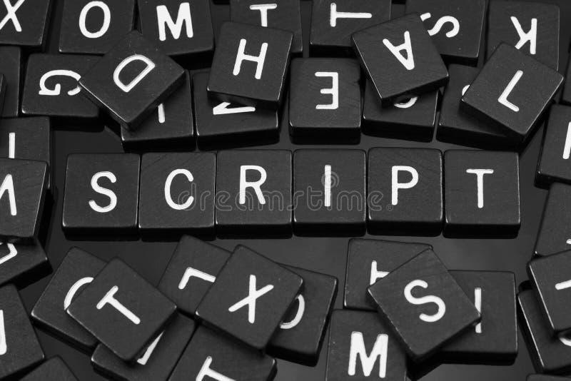 Μαύρα κεραμίδια επιστολών που συλλαβίζουν τη λέξη & x22 script& x22  στοκ φωτογραφία με δικαίωμα ελεύθερης χρήσης
