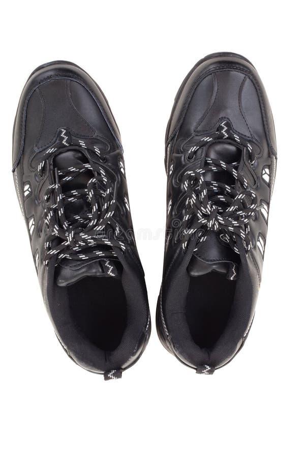 Μαύρα παπούτσια δέρματος σε μια άσπρη ανασκόπηση στοκ εικόνες