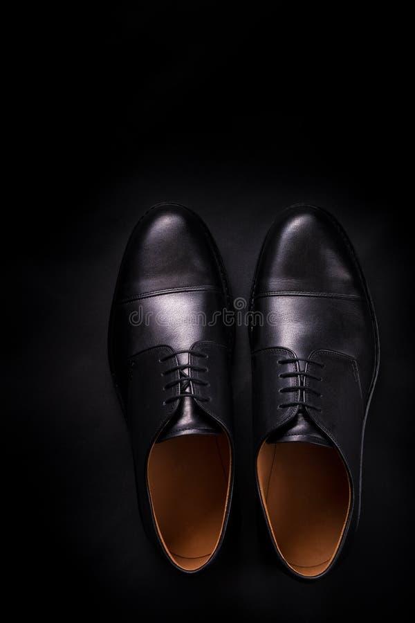Μαύρα παπούτσια της Οξφόρδης στο υπόβαθρο Τοπ όψη διάστημα αντιγράφων στοκ φωτογραφίες με δικαίωμα ελεύθερης χρήσης
