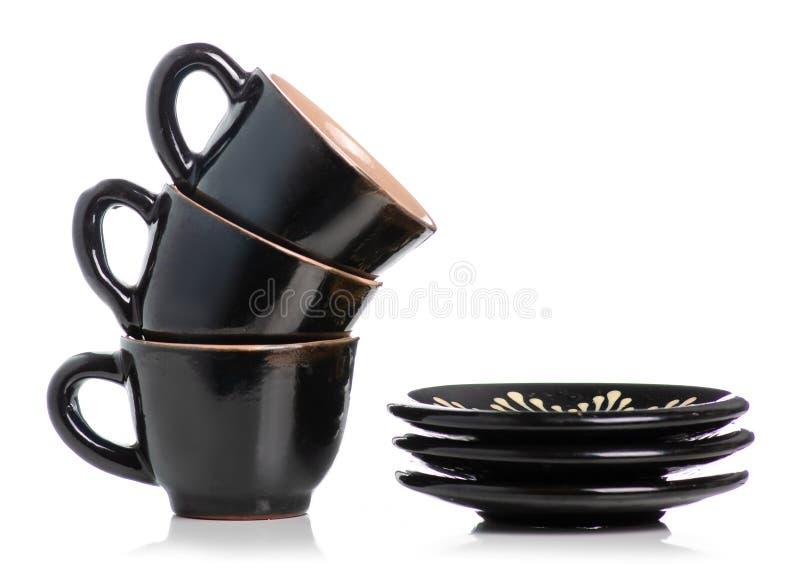 Μαύρα φλυτζάνια και πιατάκια καφέ στοκ φωτογραφία