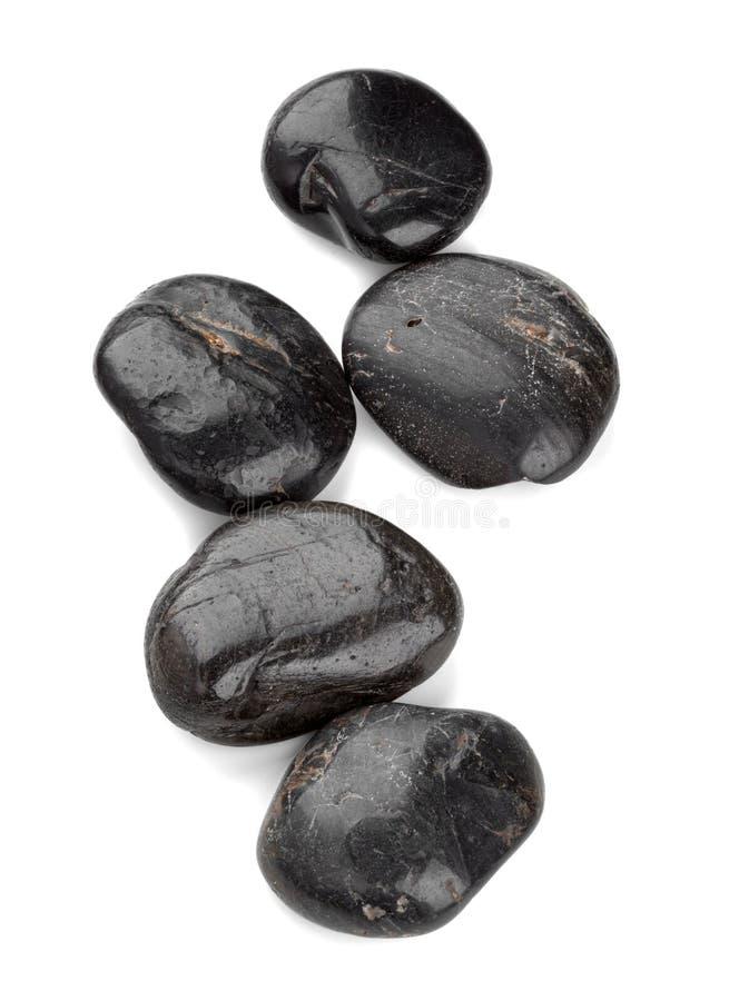 Μαύρα χαλίκια zen που απομονώνονται στο άσπρο υπόβαθρο στοκ φωτογραφίες