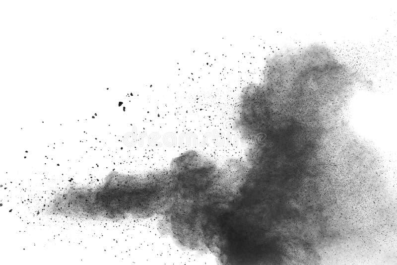 Μαύρη έκρηξη σκονών Τα μόρια του ξυλάνθρακα splatter στο άσπρο υπόβαθρο στοκ φωτογραφία με δικαίωμα ελεύθερης χρήσης